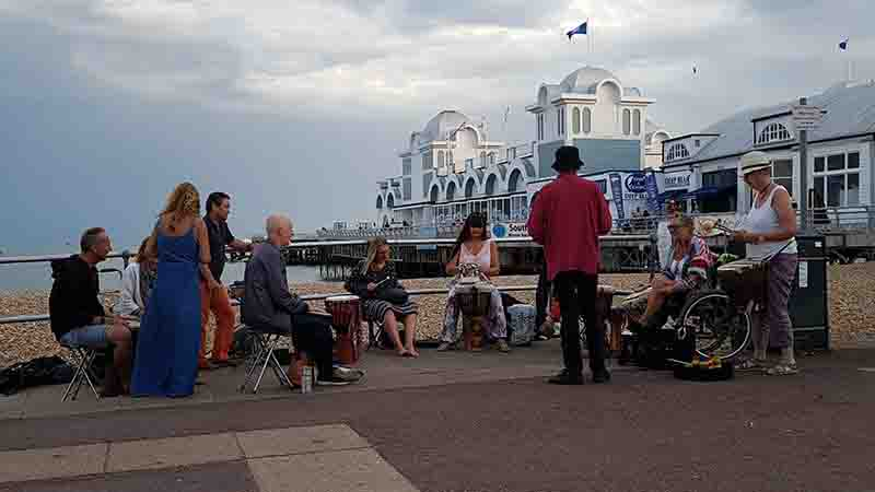 Performing next to South Parade pier, Southsea. The beachas a backdrop