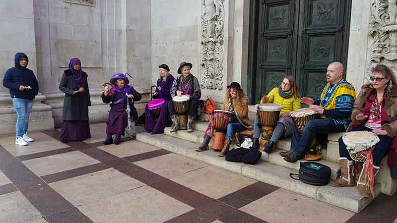 Picture of us sitting at Guildhall steps for some shelter and drum vibes